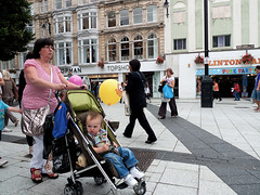 Yellow ballon (kevin Akerman) Tags: child pushchair mother mum ballon yellow street cardiff