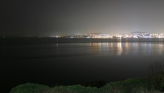 Calm night view of the Firth of Tay (milnefaefife) Tags: image27100 100xthe2019edition 100x2019 firthoftay coast fife scotland tay newportontay sea night dundee dark reflections calm tayroadbridge thebraes streetlights lights stars bridge railway