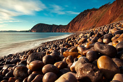 Pebbles pebbles pebbles (Christian Hacker) Tags: pebbles pebblebeach sidmouth sunshine sunny winter southdevon coast beach water sea ocean atlantic cliffs redcliffs unesco worldheritagesite jurassiccoast rocks bluesky seascape landscape uk outdoors longexposure watermovement tidal stones