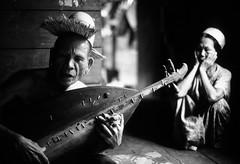 Sape Musician (Polylepis) Tags: borneo kalimantan scan kenyah indonesia longhouse music lute mahakam kodachrome eastkalimantan dayak blackandwhite monochrome olympus om film