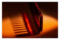 "COMB IN THE SPOT _ MM _ ""HardLight"" (Werner Demming) Tags: wernerd macromondays bokeh unschärfe olympus depthoffield mft microfourthirds tabletopphotographie macro makro color farbe hardlight domiplan50mmf28 intermediatering zwischenring red orange rot"