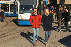 Stationsplein - Amsterdam (Netherlands) (Meteorry) Tags: europe nederland netherlands holland paysbas noordholland amsterdam amsterdampeople candid streetscene people centrum center centre stationsplein centraalstation city urban couple amour love serious serieuse man male homme guy femme girl woman female jeans sgp sunglasses red rouge tram streetcar tramway gvb siemens combino crowd public transport transportencommun january 2019 meteorry