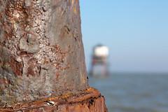 Looking past... (Dan Elms Photography) Tags: dovercourt dovercourtessex lighthouse sea coastal essex coast seaside beach england canon 5d 100mm macro macrolens rust rusty