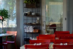 Between B'Fast & Lunch (MPnormaleye) Tags: red chairs shelves linens windows soft cafe restaurant tables door 56mm lensbaby seeinanewway