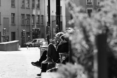 En filature (N.Hell) Tags: people man woman street photography stranger couple spy hidden bench portrait bokeh bush ambush monochrome blackwhite bw sigma 105mm contrast rue sit