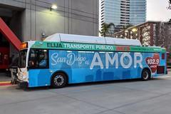 MTS Bus (So Cal Metro) Tags: mts bus sandiego sandiegotransit metro transit newflyer rt901 2900 downtown eastvillage bus2910 wrap ad advertising promotion marketing amor 1029amor