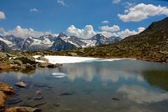 Strascichi di primavera... (quercus cerris) Tags: montagna alpi dolomiti neve laghidimontagna nuvole cielo azzurro riflessi parconaturaletrecime casere valleaurina