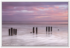 ABC_5352 (Lynne J Photography) Tags: northumberland coast seascapes sunrise water longexposure groynes outfallpipe clouds mono blackwhite pier cambois blyth rocks seatonsluice lighthouse pastel colors dawn light