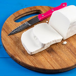 Fresh White Cheese on the round wooden board thumbnail
