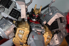 DSC_9093 (Quantum Stalker) Tags: transformers takara hasbro power primes dinobots volcanicus transform dreamwave tdw upgrade kit thigh claws gold primal qc average sword weapons