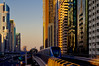 Futuristic Dubai (Bokeh & Travel) Tags: dubai futuristic future architecture uae united arab emirates metro elevated train sheikh zayed road goldenhour gold goldhour city cityscape beautiful colorful financial district sheikhzayed sunsetcolors