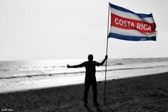 Pura Vida. (Orcoo) Tags: costarica bw byn blancoynegro blackandwhite color colors colores playa beach flag bandera uanl tigres tigresencostarica concacaf