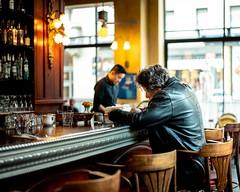 Café de la Presse (jameswilkinson1) Tags: lifestyle urban city french france travel people leatherjacket man streetpassionaward streetphotography street window bar restaurant cafe summilux leica