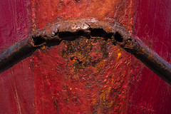 Bow of fishing boat with red paint chipping and metal rusting (Jim Corwin's PhotoStream) Tags: bellingham bellinghambaymarina pacificnorthwest squalicumharbor washingtonstate abstact aging backgrounds boat boats businessarea closeup colorimage daytime decaying fishingboat frontofboat geometricshapes harbor heavingweight horizontal industrialdistrict ironmetal lifestyle marina metal metalboat modeoftransport moored nauticalvessel nopeople nobody northwest old oldfishingboat outdoors paintchips paintedred photography pier rundown rust rustcolored rusty seaworthy shipsbow texture transportation travel used watercrafts weathered worn