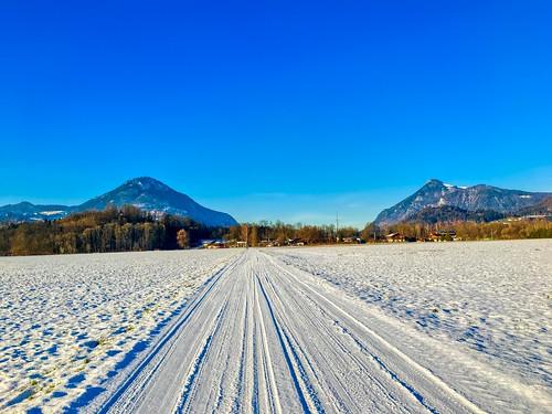 Snow covered road between Kiefersfelden and Oberaudorf, Bavaria, Germany