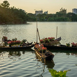 Boats with Flowers on a Lake in Saigon with Sunset in the Background thumbnail