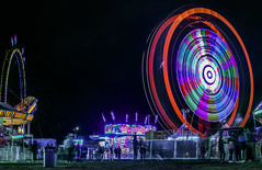 backfield midway (pbo31) Tags: bayarea eastbay alamedacounty california nikon d810 color night dark black march 2019 boury pbo31 oakland butleramusements fair traveling carnival spinning lightstream motion ride midway red footloose ringoffire