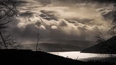Loch Ness Showers (prajpix) Tags: lochness loch lake water freshwater invernesshire highlands scotland weather clouds showers rain mist sunlight reflection village fields mountains hills silhouette birch woods woodland forest hillside tree trees moody atmospheric wet windy