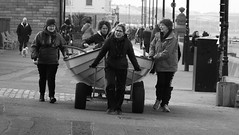 Boat Car (byronv2) Tags: peoplewatching candid street blackandwhite blackwhite bw monochrome portobello edinburgh edimbourg scotland beach sea northsea river riverforth rnbforth firthofforth forth coast coastal shore woman boat rowboat skiff wheels promenade