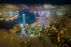 Aerial view of Hong Kong City skyline at night over the clouds (MongkolChuewong) Tags: above aerial aerialview architecture asia asian blue building buildings business china city cityscape coulds district downtown drone dusk evening flying harbor harbour hong hongkong kong landmark landscape light metropolis modern mountain night office panorama peak peaks scene sea sky skyline skyscraper sunrise sunset topview travel urban victoria victoriapeak view hk