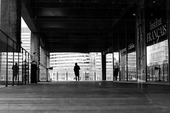 In the middle of himself (pascalcolin1) Tags: paris13 homme man citédelamode reflets reflection miroir mirror fenetres windows photoderue streetview urbanarte noiretblanc blackandwhite photopascalcolin 50mm canon50mm canon