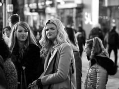 Is he...??? (captures.in.time) Tags: portrait street streetportrait candid candidphotography urban urbanphotography streetphotography edinburgh peopleofedinburgh peopleofscotland humansofedinburgh humansofscotland girl friend coat hair friends blonde waiting trafficlights scotland humans people girls smile frown