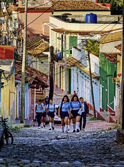 Morning in Trinidad, Cuba (creditflats) Tags: trinidad cuba unesco world heritage morning golden street candid colours colors bright buildings homes houses cobble stone stucco olympus ep5 pen micro43 school uniform children girls students