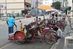 Patient Rickshaws (mikecogh) Tags: georgetown rickshaws waiting drivers rickshawstand umbrellas