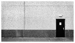 I saw a red door and I had it painted black (leo.roos) Tags: door wall deur muur industrieterrein industrialpark industrialestate tradingestate abcwestland noiretblanc a7 meyertrioplan2850 1942 projectorlens trioplan5028 projectionlens darosa leoroos