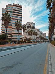 Torremolinos (lauracastillo5) Tags: city cityscape street road sky clouds blue malaga landscape outdoors boulevard vanishingpoint buildings building palms palmtrees