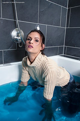 Jasmin takes a bath (Wet and Messy Photography) Tags: wet wetlook water jasmin soaked jeans heels high sweater clothes hair shower bathtub headdunk