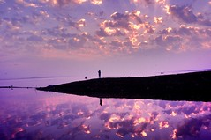 Quest. It is in one of these places where the earth meets the sky, that the human spirit of quest is fed (Rash_mint) Tags: ciel wolken himmel symmetry morning silver clouds sky water reflection