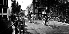 Street Scene3-BP81822bw-panorama (Rob Blok / BLOK PHOTO) Tags: street bikes girls bridge amsterdam amsterdamstreetphotography panorama nikon fx 24mm blackwhite highcontrast blokphoto robblokphotography robblokfotografie