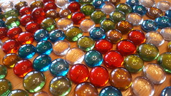 shiny rainbow (Mamluke) Tags: stones pebbles lustre glass game pieces enmasse reflection mamluke cabin verre glas vetro cristal