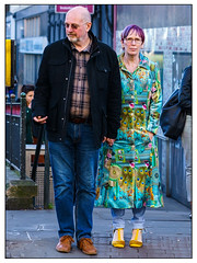Peacock fashion (Photography And All That) Tags: colour colours colourful coat people couple city street streetphotography streets fashion portrait portraits portraiture unposed sony sonyalpha7mark3 sonyalpha sonyilce7m3 crossing crossingtheroad shoes peacock pattern gaze direct stare