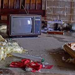 Tune in Next Week... (slammerking) Tags: television tv rabbitears florescentbulb abandoned insulation bow