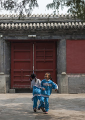 Two Kids Playing In A Courtyard, Beijing, China (Eric Lafforgue) Tags: mg0654 asia beijing child childhood childrenonly china colorpicture cute day fulllenght game girls innocence outdoors pekin playing realpeople street twopeople twopersons vertical