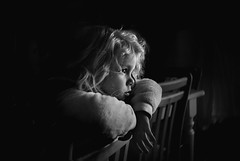 Patience (Kapuschinsky) Tags: blackandwhite bnw monochrome emotive moody atmospheric sidelight sonyalpha bealpha sonya900 lensbaby seeinanewway burnside35 pennsylvaniaphotographer kapuschinsky portrait portraiture childportrait profile curls lowlight lifestyle candid candidportrait