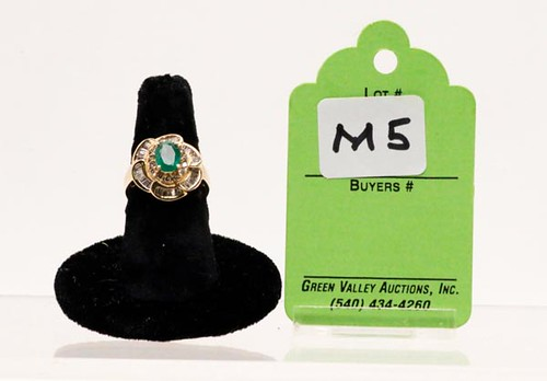 14k yellow gold lady's ring w/ 1 oval shaped emerald, 36 baguette & 14 round diamonds, size 7, approx. 1.0 ct. ($1,176.00)