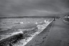 Stormy Firth of Clyde (Joe Son of the Rock) Tags: clyde firthofclyde helensburgh esplanade westesplanade blackandwhite monochrome storm rain wind wave path walkway peninsula roseneathpenisula pathscaminhos rnbclyde pathscaminhosjoin group people paths