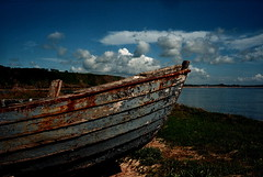 Rusty Boat (gcobb84) Tags: leica m6 summicron boat clouds shore beach landscape