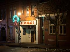 Flashback (HWW) (13skies) Tags: glass nightshot night nighttime parison store longexposure flashback clothing hww happywindowwednesday windowwednesday streetlights lights tree brick sign sonya99