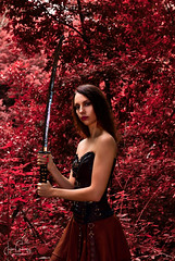 Warrior Girl [explored] (gjaviergutierrezb) Tags: warrior girl sword red attractive women forest
