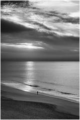 "Stranger On The Shore (""A.S.A."") Tags: portugal algarve europe atlantic coast sunrise sunburst cloud beach sonya7rmkii sony2470f28gm blackwhite mono monochrome greyscale niksoftware silverefex asa2019"