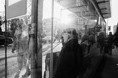 Waiting (ewitsoe) Tags: bnw blackandwhite warsaw warszawa erikwitsoe nikonfm2 film analog analogue rpx rollei films street urban city poland man sitting bench waiting tram stop crowd people polska