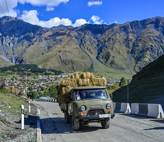 A truck carrying grass on mountain road (phuong.sg@gmail.com) Tags: adventure altitude beautiful car danger dangerous drive europe georgia high highway kazbegi land landscape mount mountain mountains nature north outdoor path prayer precipice road rock rocks rural scenery scenic steep summer sunnyday tourism transport transportation travel truck vehicle village way