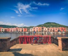 Bosa_180170 (ivan.sgualdini) Tags: 1635mm italy seaitaliano amazing bicycle boat bosa bridge canon city concerie italia light magic red reflections river sardegna sardinia sunset temo town water