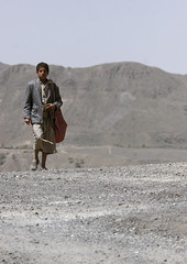 Boy Walking On The Desert, Yemen (Eric Lafforgue) Tags: adult alone arabia arabiafelix arabianpeninsula bag bigbag blue bluesky boy carpolite child cloudy colourpicture day fulllength gray green hill lonely man mountain oneboy oneperson oneyoungman placeofinterest realpeople serious seriously stick stone vertical walk walking yemen youngadult youngman img1476 copyspace hababa