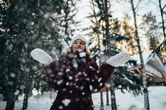 Winter Days (Top KM) Tags: winter snow girl warm clothing snowing knit hat coat outdoors finland woman female trees cold frost recreation wood frozen snowy people adult one person chilly folk outdoor nature outside sunlight weather season