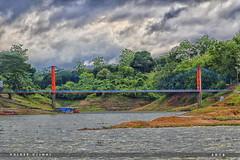 ঝুলন্ত সেতু.... (Halder Ujjwal) Tags: ngc beautifulbangladesh bangladesh beauty asia nature outdoor hangingbridge catenarybridge chainbridge bridge rangamati kaptailake ঝুলন্তসেতু রাঙামাটি বাংলাদেশ color contrast clouds water canon 7dmarkll green landscape